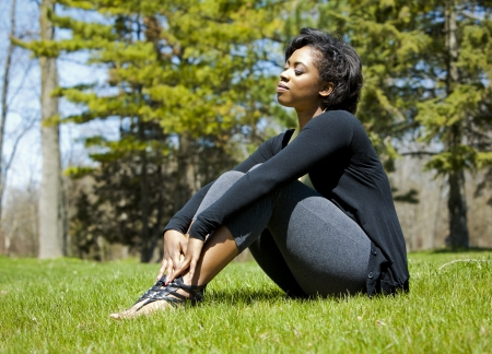 pretty black woman enjoying summer in the park Stock Photo - 19407074