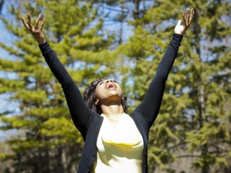 pretty black woman enjoying summer in the park Stock Photo - 19407067