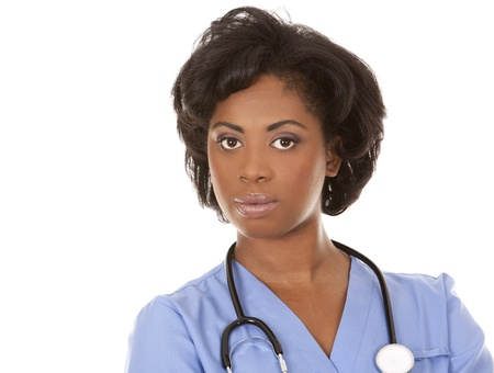 black nurse wearing scrubs on white isolated background Stock Photo - 19458219