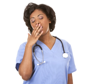 black nurse wearing scrubs on white isolated background Stock Photo - 19458203
