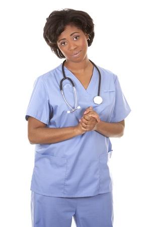 black nurse wearing scrubs on white isolated background Stock Photo - 19458218