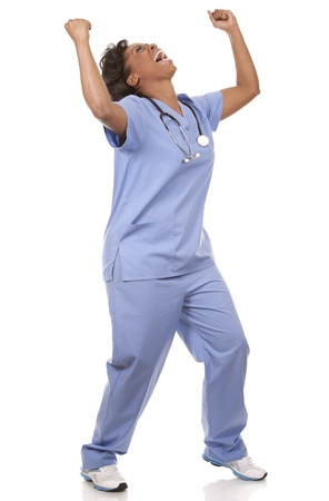 black nurse wearing scrubs on white isolated background Stock Photo