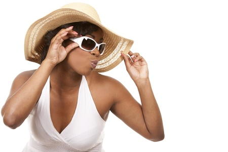 pretty black woman wearing white summer outfit on white background Stock Photo - 19458217
