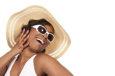 pretty black woman wearing white summer outfit on white background Zdjęcie Seryjne - 19458233