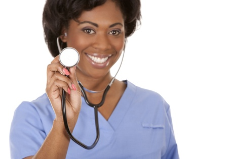 black nurse wearing scrubs on white isolated background Фото со стока
