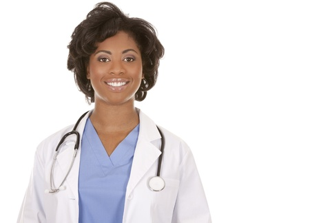 working woman: black doctor wearing scrubs and lab coat on white isolated background Stock Photo
