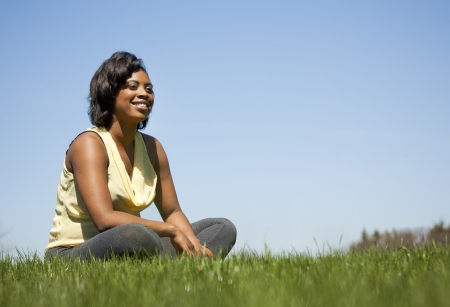 pretty black woman enjoying summer in the park photo