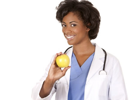 black doctor wearing scrubs and lab coat on white isolated background photo