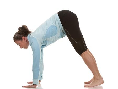 brunette wearing fitness wear on white background Stock Photo - 19799086