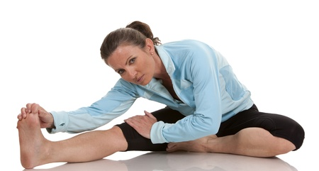 brunette wearing fitness wear on white background Stock Photo - 19799082