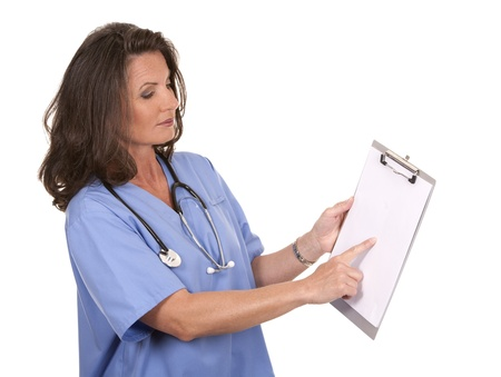 mature brunette: female nurse holding files on white background
