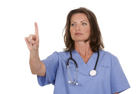 female nurse wearing scrubs on white isolated background Stock Photo - 19907585