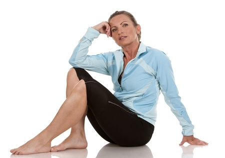 sportive: brunette wearing fitness wear on white background