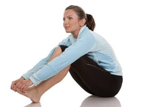 brunette wearing fitness wear on white background Stock Photo - 19907619