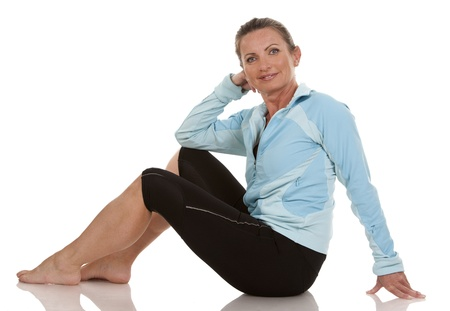 brunette wearing fitness wear on white background Stock Photo - 19907620