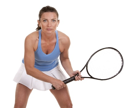 brunette playing tennis on white background Stock Photo - 20049599