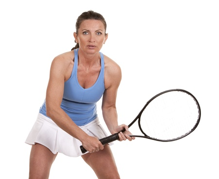 brunette playing tennis on white background photo