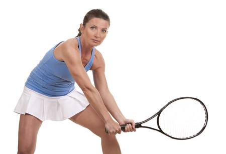 brunette playing tennis on white background Stock Photo - 20049601