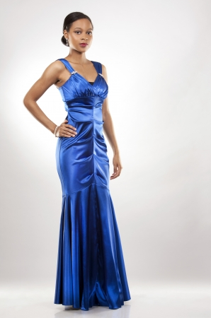 beautiful woman wearing blue evening dress on light background Stock Photo - 20787385