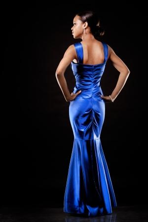 beautiful woman wearing blue evening dress on black background Stock Photo - 20787390