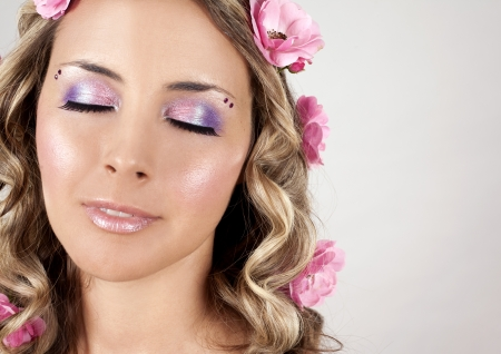 summer woman wearing pink roses and colorful makeup
