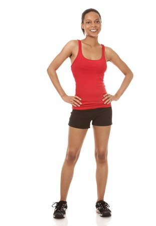 beautiful black woman wearing red fitness outfit on white background Stock Photo - 21133961