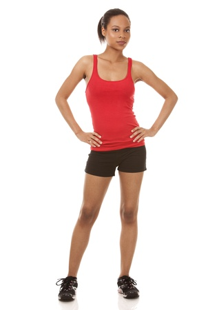 beautiful black woman wearing red fitness outfit on white background Stock Photo - 21133958