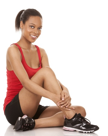 beautiful black woman wearing red fitness outfit on white background Stock Photo - 21133965