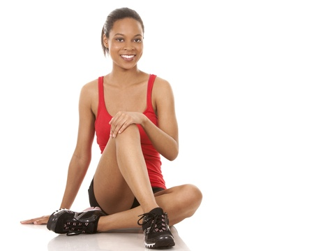 beautiful black woman wearing red fitness outfit on white background Stock Photo - 21133967