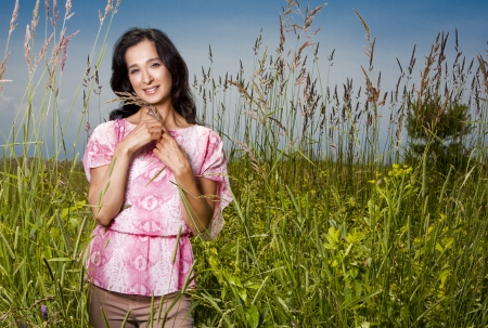 summer woman standing in the grass in the sun Stock Photo - 21172559