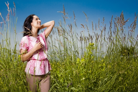 summer woman standing in the grass in the sun Stock Photo - 21172562