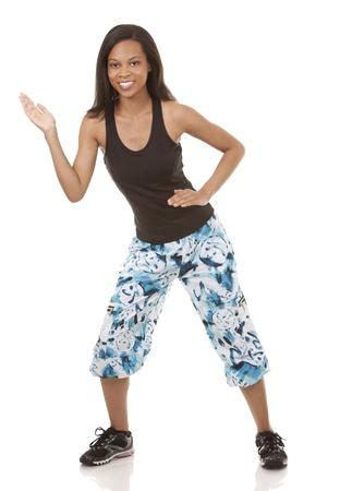 zumba: pretty woman exercisig zumba on white isolated background