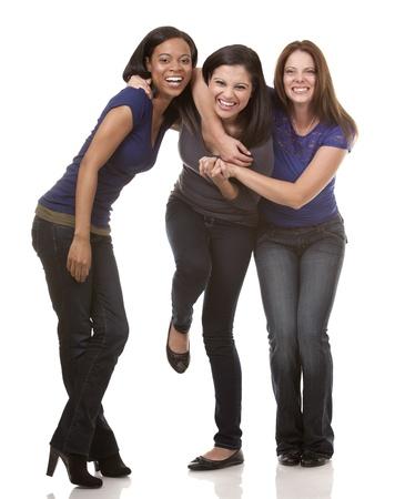 beautiful three women having fun on white isolated background