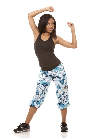 pretty woman exercisig zumba on white isolated background photo