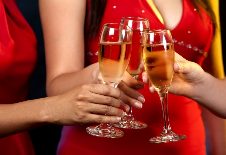 beautiful three women holding glasses with champagne photo