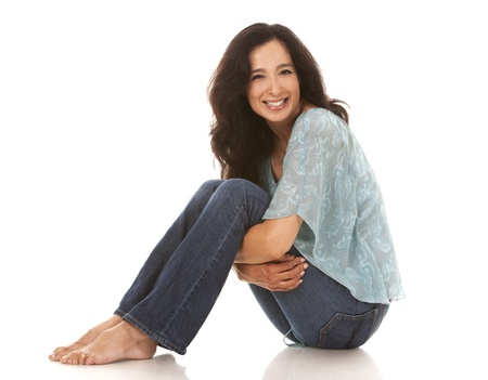one mid adult woman: pretty brunette in her 40s wearing casual outfit on white background
