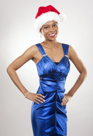 beautiful woman wearing blue evening dress and Christmas hat Stock Photo - 22172731