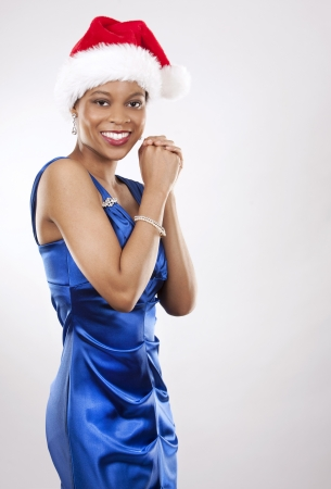 beautiful woman wearing blue evening dress and Christmas hat Stock Photo - 22172744