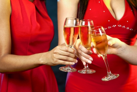 festive occasions: beautiful three women holding glasses with champagne