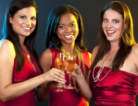 beautiful three women holding glasses with champagne