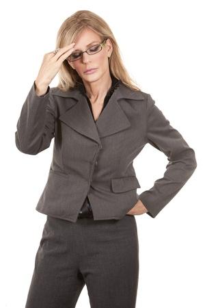 blond mature woman having a headache on white background photo