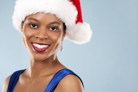 beautiful woman wearing blue evening dress and Christmas hat Stock Photo - 22361741