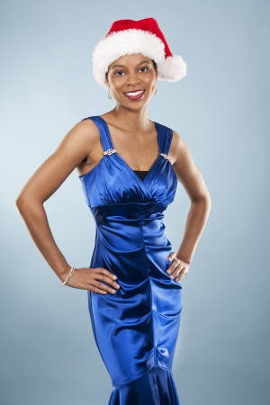 beautiful woman wearing blue evening dress and Christmas hat Stock Photo - 22361742