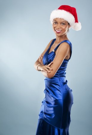 beautiful woman wearing blue evening dress and Christmas hat Stock Photo - 22361744
