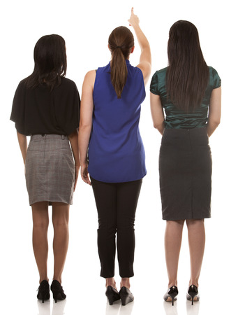 people from behind: group of women wearing office outfits on white isolated background Stock Photo