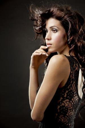 long: fashion model brunette wearing black outfit