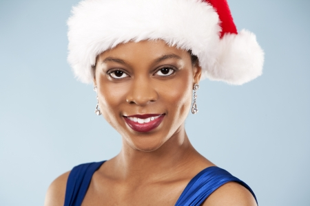 beautiful woman wearing blue evening dress and Christmas hat photo