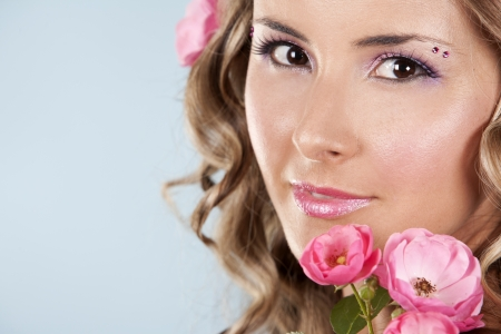 summer woman wearing pink roses and colorful makeup photo