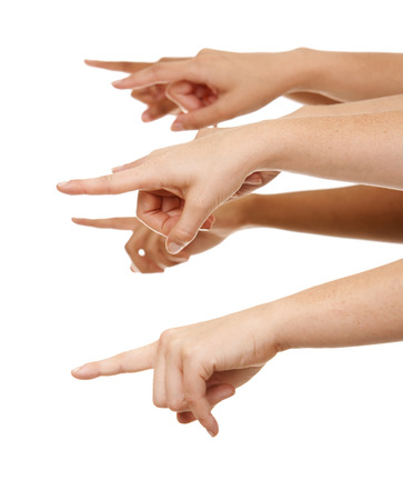 group of hands pointing on white isolated background photo