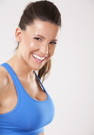 fitness model brunette wearing blue outfit on light background Stock Photo - 25068441